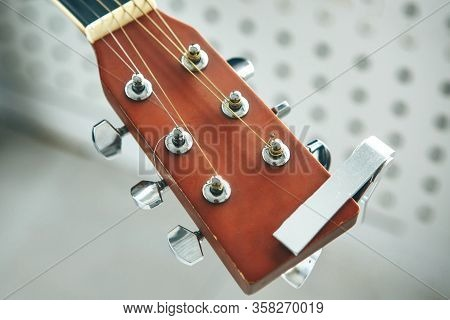 Close-up Of A Fretboard Guitar With Strings. The Concept Of Learning To Play The Guitar.