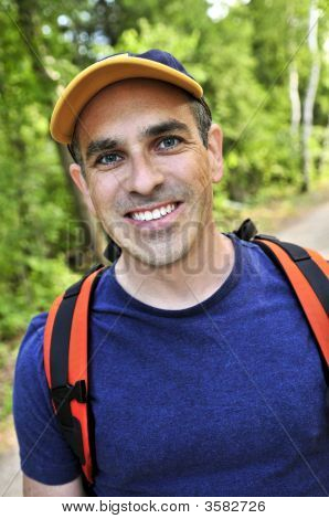 Man Hiking On Forest Trail