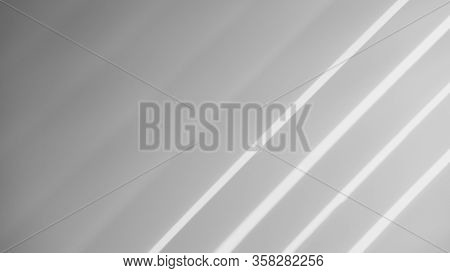 Abstract Shadow Batten Of Lath And Morning Light On White Concrete Wall Texture Background