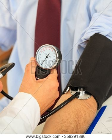 Doctor Measuring Blood Pressure, Closeup Vertical View