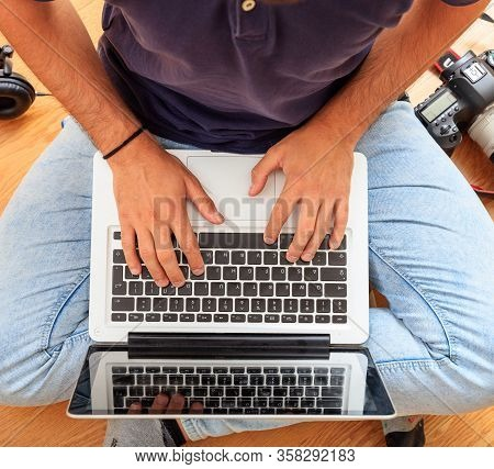 Man Working With A Laptop On The Floor. Work From Home.