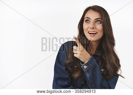 Excited, Fascinated And Curious Caucasian Woman Seing Interesting, Cute Product At Store, Pointing F