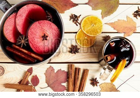 Mulled Wine. Winter Hot Drink With Citrus, Apple And Spices. Stewpan With Mulled Wine And Cinnamon S