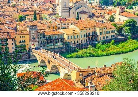 The Ponte Pietra Stone Bridge, Pons Marmoreus, Roman Arch Bridge Across Adige River, Buildings With