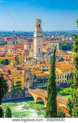 Vertical View Of Verona Historical City Centre, Ponte Pietra Bridge Across Adige River, Tower Of Ver