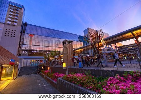 Kyoto, Japan - April 27, 2017: Kyoto Tower With Observation Deck, Reflects On Glass Facade Of Statio