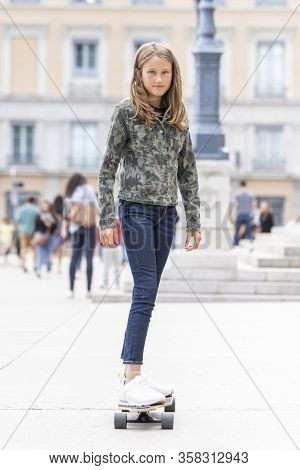 Portrait Of Teenage Girl On Skateboard, France