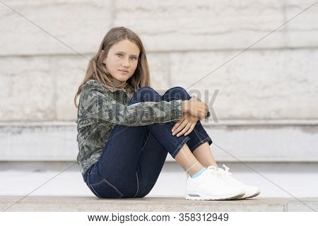 Horizontal Portrait Of Teenager Girl Outdoor, France