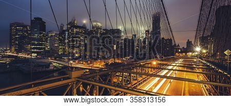 Panoramic View On Brooklyn Bridge By Night, New York, Usa