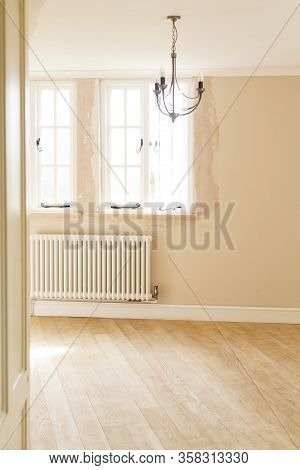 House Renovations, Refurbishment Of A Room Including Plastering,  New Windows And New Floor In A Uk