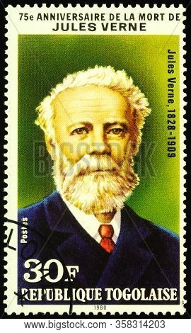 Moscow, Russia - March 29, 2020: Stamp Printed In Togo Shows Portrait Of Jules Verne (1828-1905), Gr