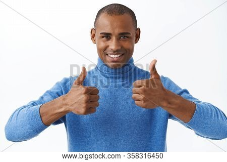 Best Deal Online. Portrait Of Confident African American Man Assuring Its Good, Show Thumbs-up As Re