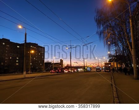 City Street, Cars And Buildings On A Sunset Background.
