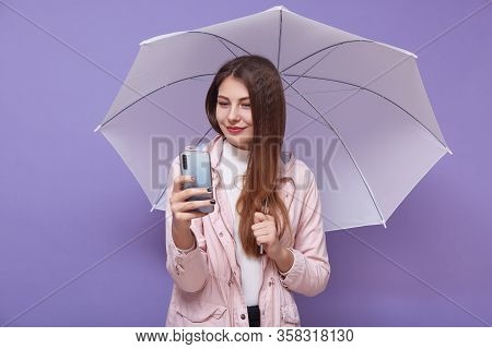 Image Of Beautiful Tender Attractive Young Woman Making Selfie, Talking Over Videocall, Holding Smar