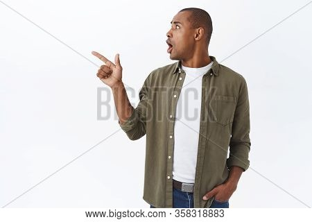 Portrait Of Shocked, Alarmed African-american Handsome Guy Looking Worried And Frustrated, Turn Head