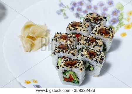 Sushi And Rolls Home Delivery. Krpny Plan. Sesame, Salmon, Cheese.