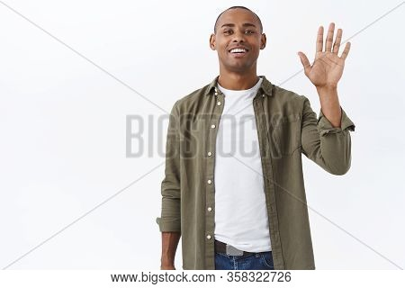 Portrait Of Friendly African-american Male In Casual Outfit, Seeing Person In Crowd, Attract Friends