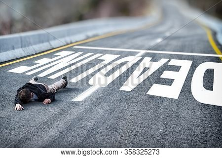 Tired Powerless Man In Black Jacket And Grey Trousers Fallen On Road Overcome Deadline Title Written
