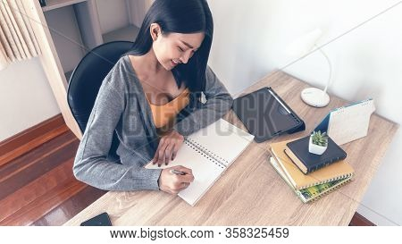 Calendar Reminder Event Concept.woman Hand Planner Or Organizer Writing On Diary Book And 2020 Calen
