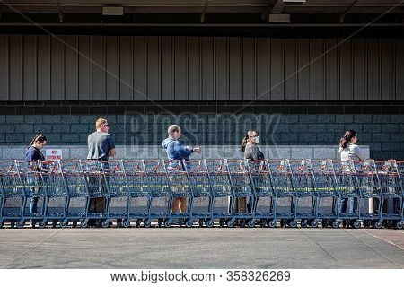 Tucson, United States  - March 29: Five Unidentified Shoppers Practicing Social Distancing Lined Up