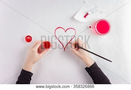St. Valentines Day Background. Girl Drawing With Paints Heart On White Background.card Concept.copy