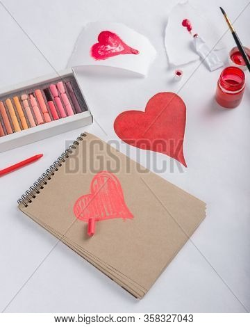 St. Valentines Day Background. Girl Drawing With Paints Heart On White Background.card Concept.
