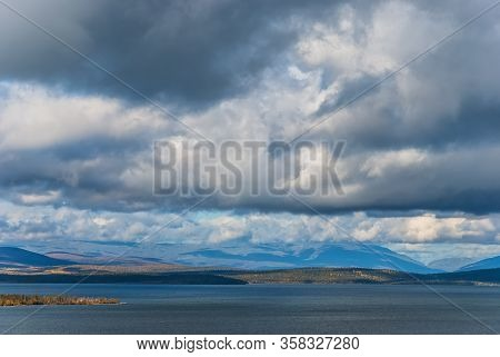 Russian North Nature Landscape. Kola Peninsula Landscape With Thik Clouds And Hills
