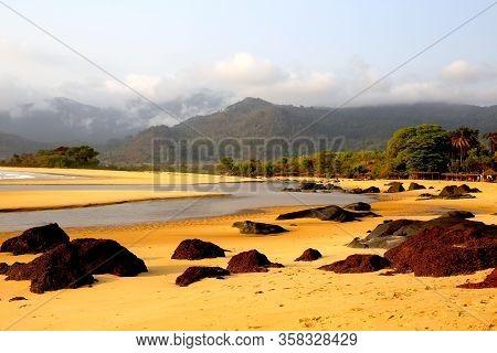 Sierra Leona, Playa Tropical Y Rio Que Desciende Hasta La Orilla