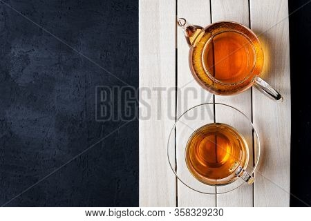 Tea, Brewed In A Transparent Teapot.dark Background.the View From The Top.