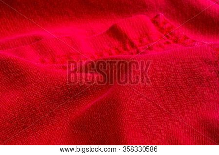Clothing Items Stonewashed Red Cotton Fabric Texture With Seams, Clasps, Buttons And Rivets, Macro