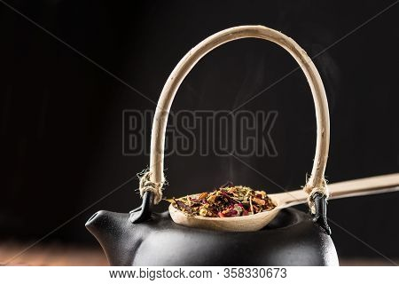 Process Of Brewing Tea In A Ceramic Teapot.herbal Tea, Rustic Style, Wooden Background.