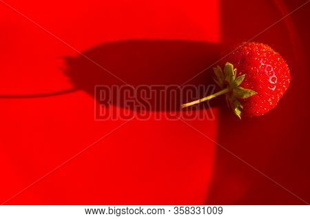 Fresh Ripe Berries Strawberries On Red Ceramic Plate, Close Up