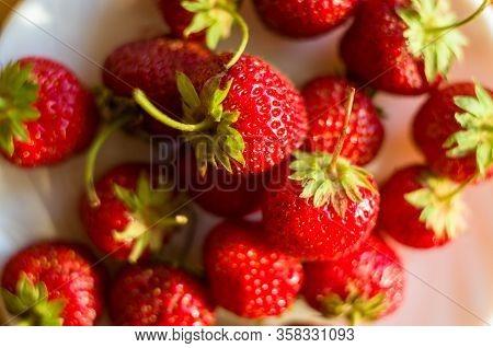 Fresh Ripe Berries Strawberries On White Ceramic Plate, Close Up