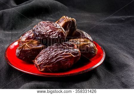 Big Luxury Dried Date Fruit In Bowls On The Dark Surface, Kurma Ramadan Kareem Concept, Close Up.