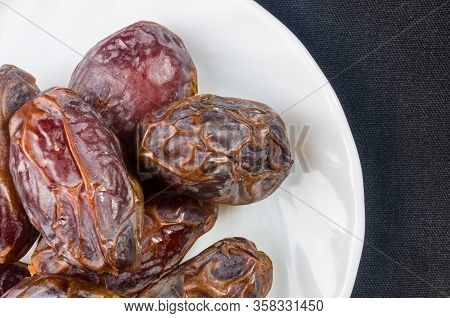Big Luxury Dried Date Fruit In Bowls On The Dark Surface, Kurma Ramadan Kareem Concept, Close Up.