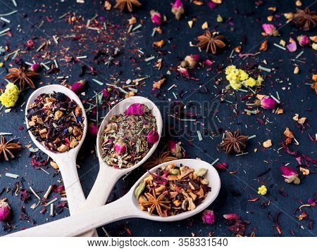 Set Of Different Tea In Wooden Spoons, Rustic Style, Wooden Background.