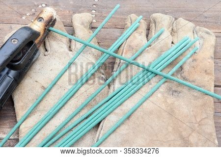 Necessary Tools For Electro Welding, Welding Electrodes, Electrodes Holder And Leather Gloves.