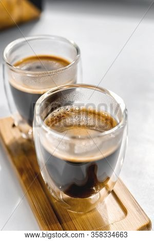 Two Cups Of Fresh Espresso On A Wooden Tray, On A White Background. Sunlight From The Window