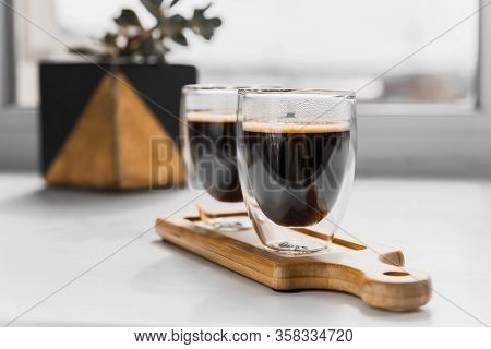 Two Cups Of Fresh Espresso On A Wooden Tray, On A White Background. Sunlight From The Window And Pla