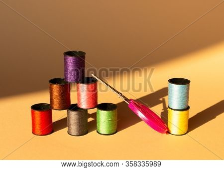 Creative Composition With Spools Of Colored Threads And Scissors. Sewing Accessories, Tailoring Set.