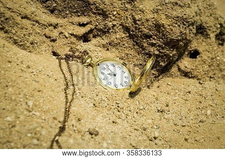 An Pocket Watch  On A Pile Of Sand In Deadline Concept