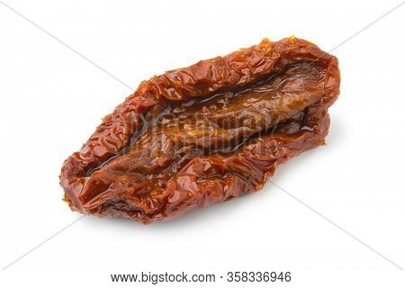 Single sundried tomato in olive oil isolated in white background