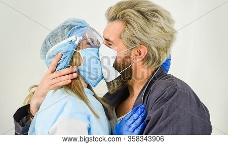 Couple Kissing Through Face Masks. Hygiene Concept. Avoid Contact With Other People. Virus Transmitt