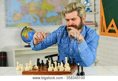 Figures On Wooden Chess Board. Smart Hipster Man Playing Chess. Intellectual Hobby. Thinking About N