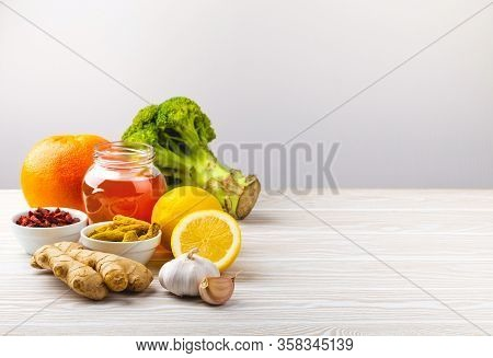 Food For Immunity Stimulation And Viruses Protection, Space For Text. Broccoli, Citrus Fruits, Honey