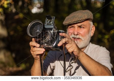 He Likes Birdwatching. Make Perfect Frame. Old Photographer Filming. Manual Settings. Pension Hobby.