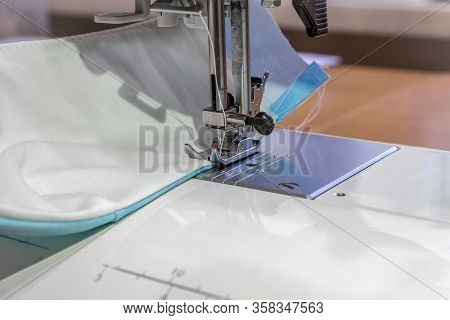 Sewing A Reusable Medical Mask At Home. Step 4. Sewing The Mask On A Sewing Machine. Sew Along The E