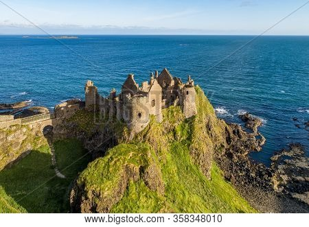 Ruins Of Medieval Dunluce Castle On A Steep Cliff. Northern Coast Of County Antrim, Northern Ireland