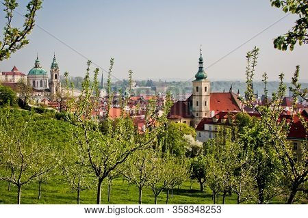 Scenic View From Petrin Park Towards Saint Nikolas Cathedral, Through Fresh Spring Blooming Trees, P