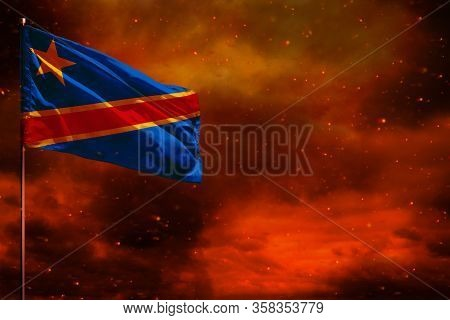 Fluttering Democratic Republic Of Congo Flag Mockup With Blank Space For Your Data On Crimson Red Sk